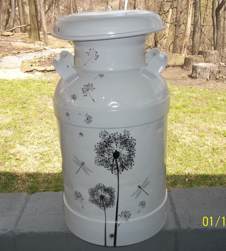 """refurbished """"milk"""" can: primed and painted, adorned with dollar store wall decals."""