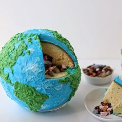 You won't believe the cool surprise waiting INSIDE this Earth cake! via Hungry Happenings