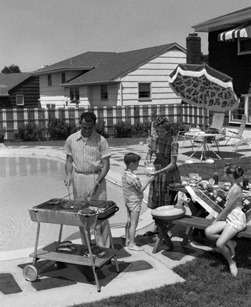 A suburban 1950s family enjoys a lovely poolside barbeque.
