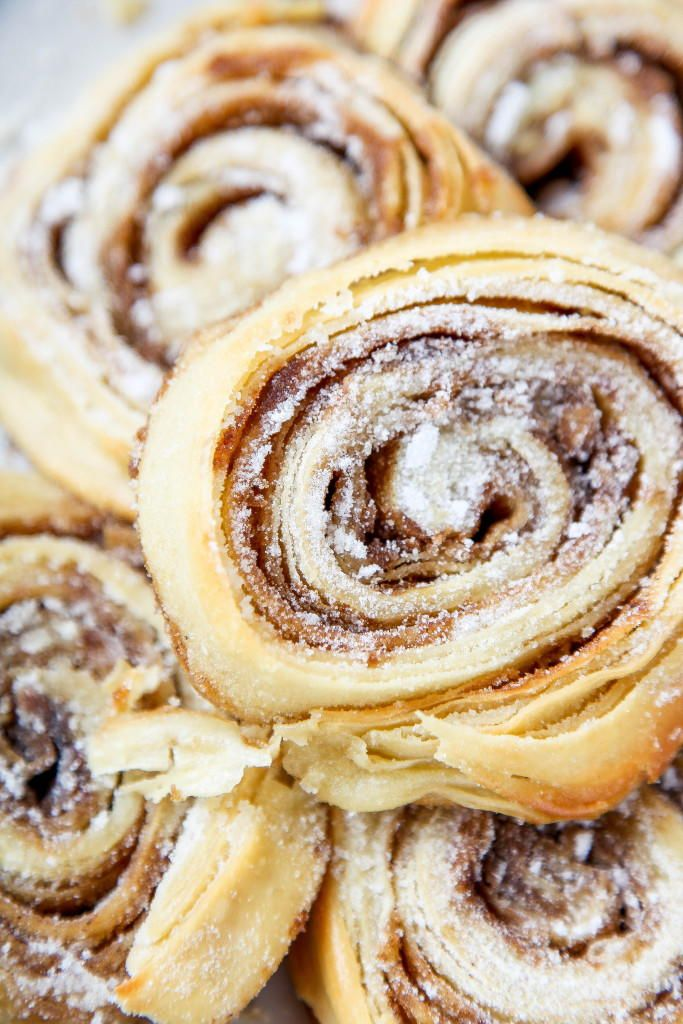 """""""Buttery, flaky rolls covered full of cinnamon sugar. If a pie crust, and a cinnamon roll had a baby it would be these tasty bad boys! The original recipe calls for all spice, but I chose to use cinnamon instead."""""""