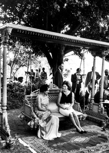 "The caption that accompanied this photo in LIFE: ""On a carved wooden swing in the prime minister's garden, the First Lady sits and talks with Mrs. Indira Gandhi, Nehru's daughter and the former president of the ruling Congress party of India."" Indira Gandhi became Prime Minster herself in 1966."