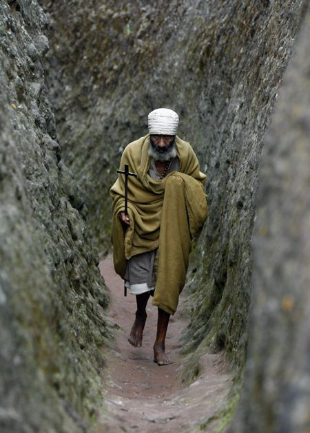 Orthodox monk leaves a rock hewn church after prayers in Lalibela