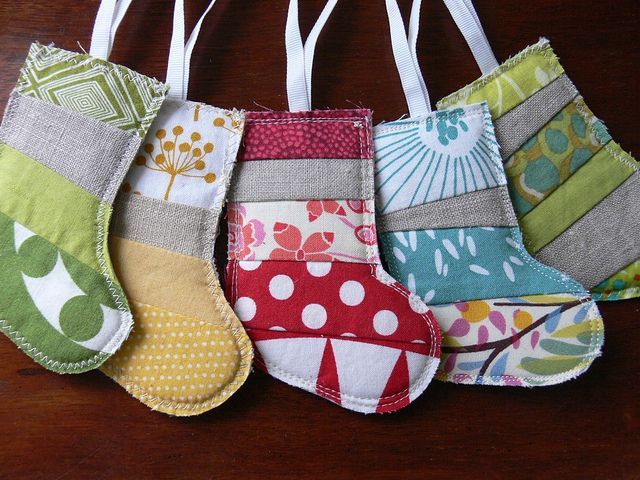 Oooh I like these - another use for the old interior design sample books!!  Jenny: Scrappy Stocking Christmas Ornament by Stumbles & Stitches, via Flickr