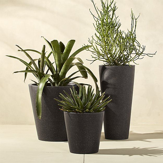 Shop shore tall polyterrazzo planter. Modern faux-stone planter is handmade from an innovative polystone material that resembles natural limestone—both in looks and durability. Modern conical shape and natural finish blend nicely with any decor.