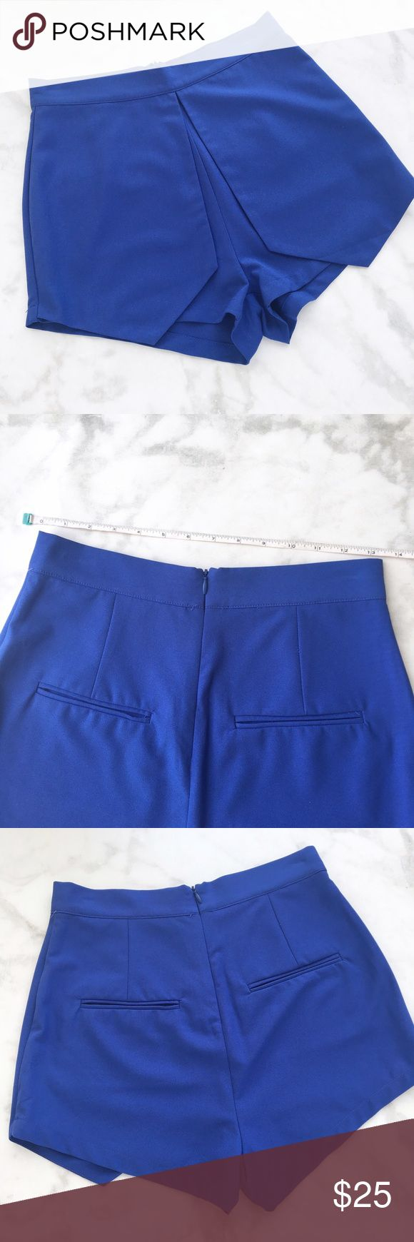 ROYAL BLUE FRONT FOLD OVER SHORTS Royal Blue short Sold over front for skort look  Back zipper closure 100% Polyester. Style Link Miami Shorts