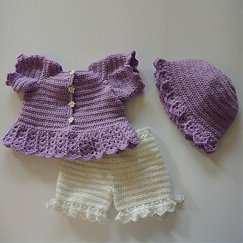A PDF Crochet Pattern of a dress, shorts and hat.