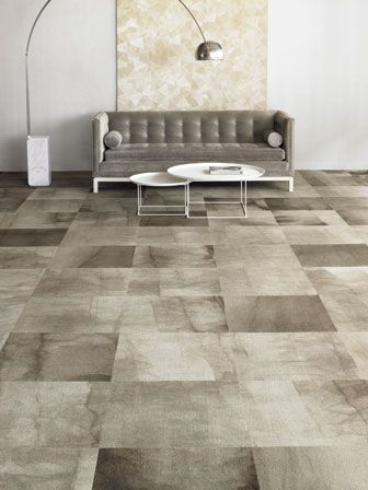 The carpet tiles- love the organic looking dye, they look almost like stone tiles!