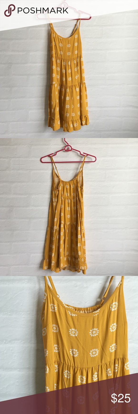 Sunflower Dress Cute mustard yellow sunflower dress. 3 tiers with ruffle hem. Adjustable spaghetti straps. Elastic in back. Brand new, never been worn. Super cute but yellow isn't my color. Mossimo Supply Co. Dresses Mini