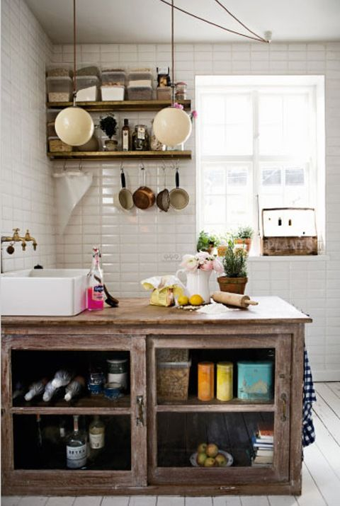 white floors, colored tins, globe lights and copper pots