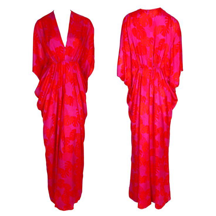 A red and pink printed floor-length Kaftan gown with a V-neckline and draped sleeves by Issa London #issa #print #dress #gbmoda #kaftan #draping #ramadan #luxury #hautecouture #greenbird #trend #elegance #dubaifashion #abudhabi #marinamall #fashion