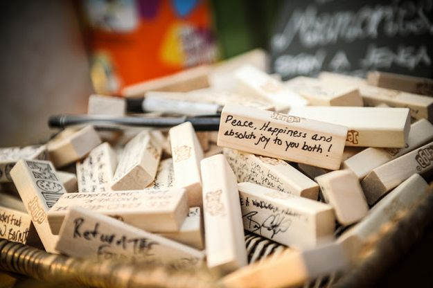 """A """"guest book"""" consisting of Jenga blocks signed by the wedding guests."""