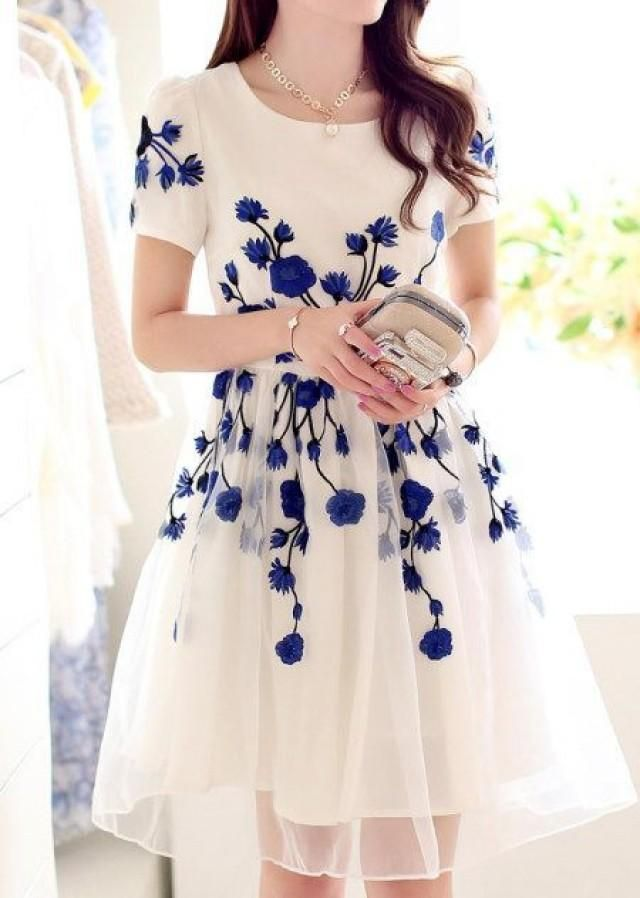Feminine and dainty white dress with blue floral design - love this for a spring wedding gardenparty gardenwedding wedding dress blue garden