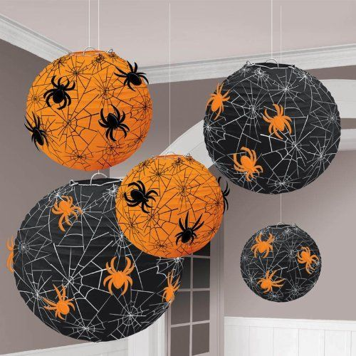 """Spider Web Printed Paper Lanterns by Amscan. $5.84. CAUTION: Please keep away from flame and direct heat sources. For decorative use only.. Includes: 5 Spider Web Printed Paper Lanterns, 24 Spiders and 1 Strip of Foam Tape. Includes (5) Spider Web Printed Paper Lanterns with attachments. Sizes are 5.75"""", 7.75, and 9.5"""" in diameter.. Save 55% Off!"""