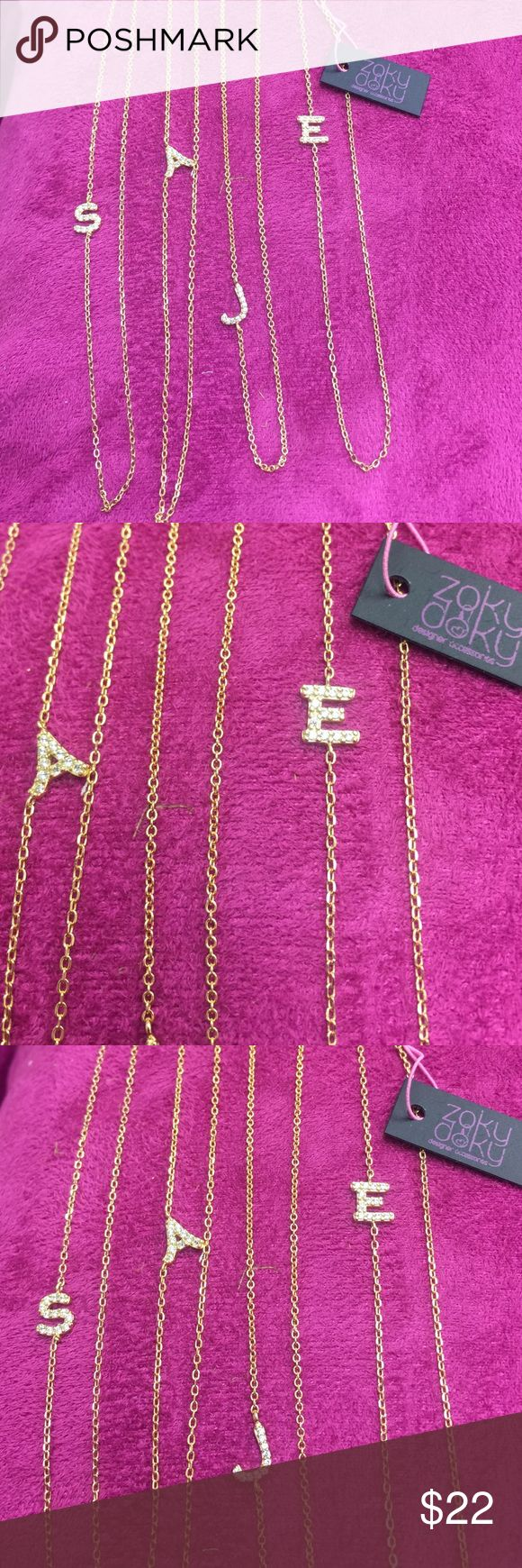 CZ Side Chain Initial Necklaces, NWT,18k Vermeil Special Price Promotion! 🛍Choose .925 Sterling Silver with CZ initial letter or 18k Gold Vermeil Necklaces. Limited Quantities please ask if I have you letter in stock. And specify color. Price FIRM unless bundled. Current stock..S,N, M,A,C,E,j, T left in the gold and the silver....c,E,J,k,M,S,R ZokyDoky Jewelry Necklaces