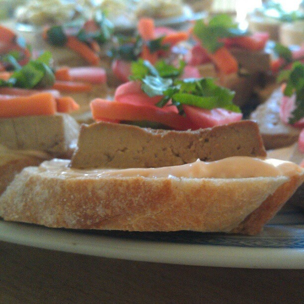 ... ginger soy seared tofu, homemade pickled carrots and radishes, toasted