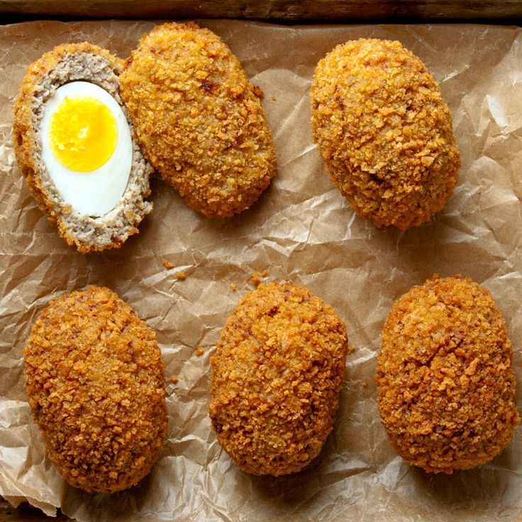 Scotch Egg 6 whole eggs in their shells, plus 1, lightly beaten 1 lb. ground pork sausage 1 tbsp. Worcestershire sauce 1 tbsp. English mustard 2 tsp. cornstarch ¼ tsp. ground mace 2 leaves sage, finely chopped 2 sprigs thyme, finely chopped Kosher salt and freshly ground black pepper Canola oil, for frying ¼ cup milk ½ cup flour 2 cups panko bread crumbs