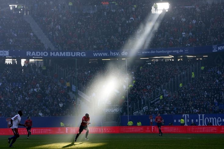 A ray of light shines down on Hannover's Jiri Stajner during a Bundesliga match against Hamburg in February 2008.