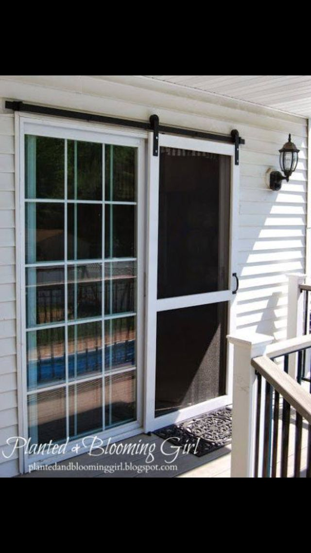 "Sliding ""barn door"" glass and screen for porch entrance"