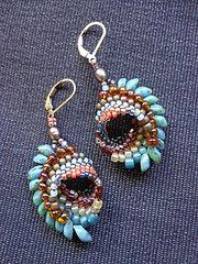 Cellini spiral earrings - they look like dragon eyes