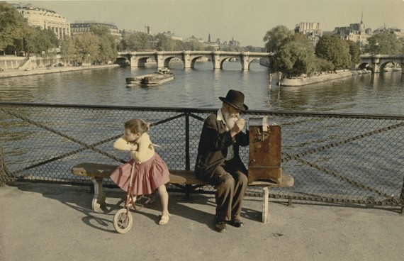 Barrel Organ Player and a child on the Pont des Arts in Paris   a 1950s Peter Cornelius photo