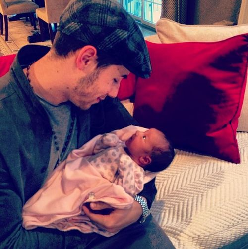 Uncle Nick Jonas Holds Baby Alena Rose (February 6, 2014). The Jo Bros will always have a place in my heart <3