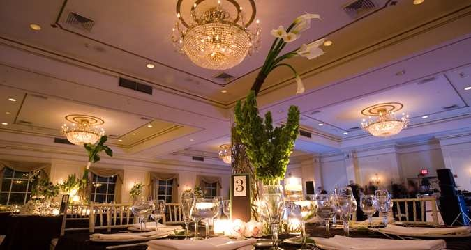 The elegant Grand Ballroom at #Hilton Pearl River with its sea of crystal chandeliers, floor to ceiling windows and gilded moldings is the perfect setting for a New York wedding.