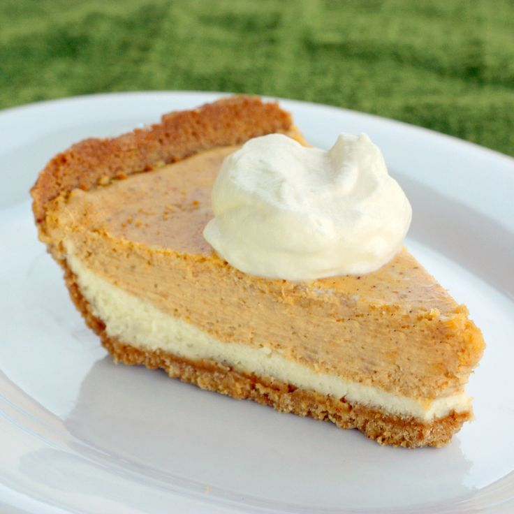 Double Layer Pumpkin Cheesecake - a layer of cheesecake topped with a layer of pumpkin cheesecake in a graham cracker crust. the-girl-who-ate-everything.com