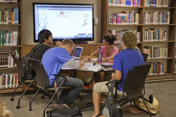 Love how this collaboration table fits in witth the bookshelves. Jenison High School, media center