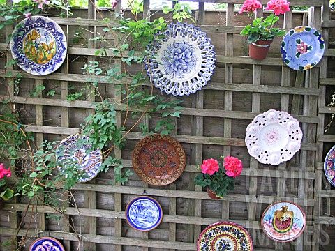 Plates n' pots: maybe more urban vibe with funky junk colored glass plates to create a stained glass effect. maybe larger volume pots w/ lime green cascading vines...