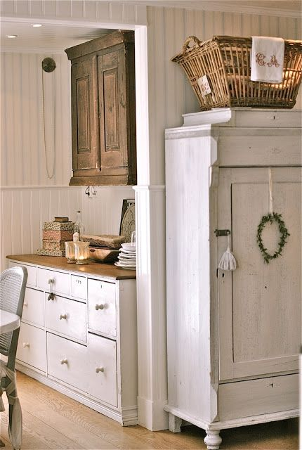 Distressed Antique white furniture w/ pale reclaimed wood floors