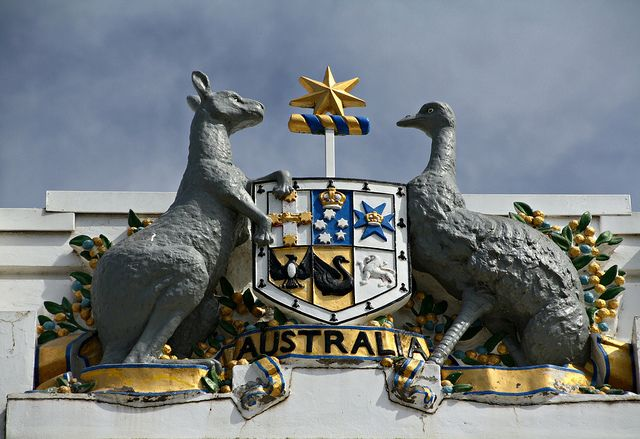 Red Kangaroo & the Emu feature on Australia's Coat of Arms, seen here atop of Old Parliament House, Canberra. It features a shield depicting the badges of the six Australian states supported by two native Australian animals - the Red Kangaroo & the Emu. It's believed both the Kangaroo & Emu were chosen to symbolise a nation moving forward, due to a common belief that neither animal can move backwards easily  - Canberra, ACT.