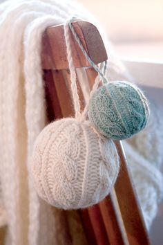 Cabled globe ornaments made by No Home without You. Free pattern Knitting Daily.