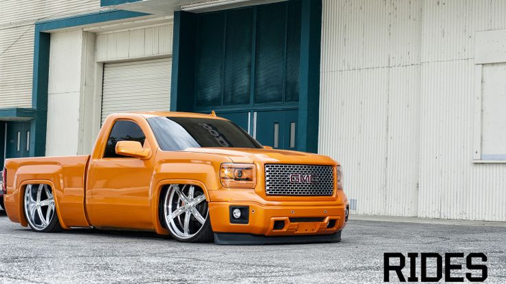"Bagged Orange GMC Sierra on 28"" intros- Love this look"