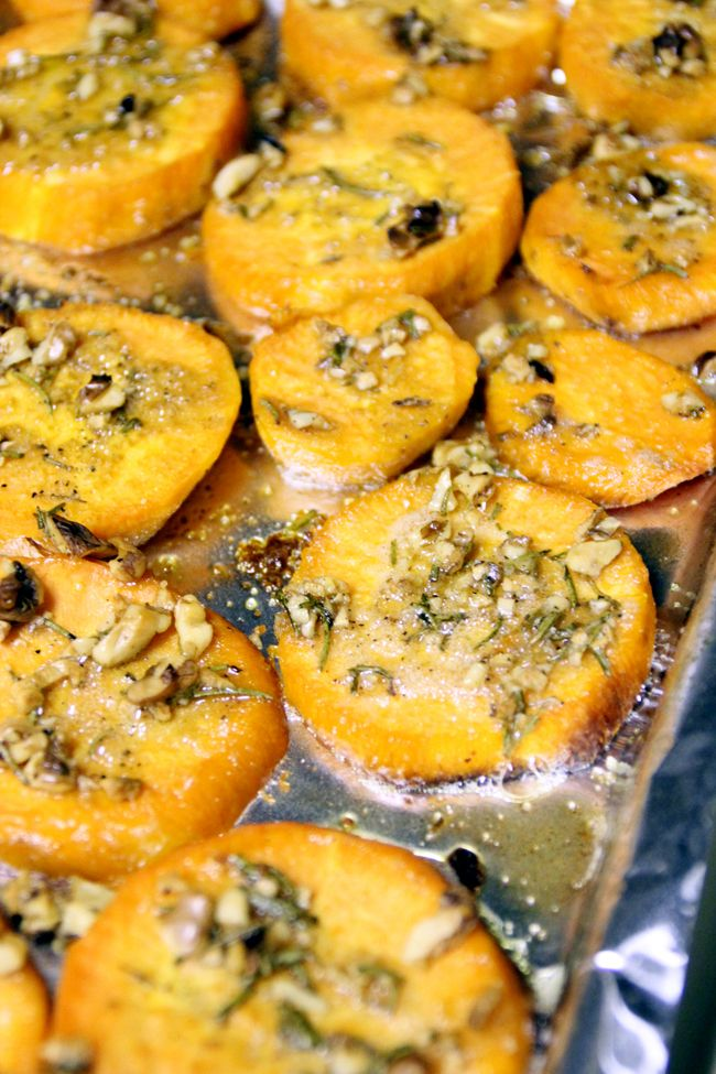 Roasted sweet potatoes with olive oil, garlic, walnuts, and rosemary.
