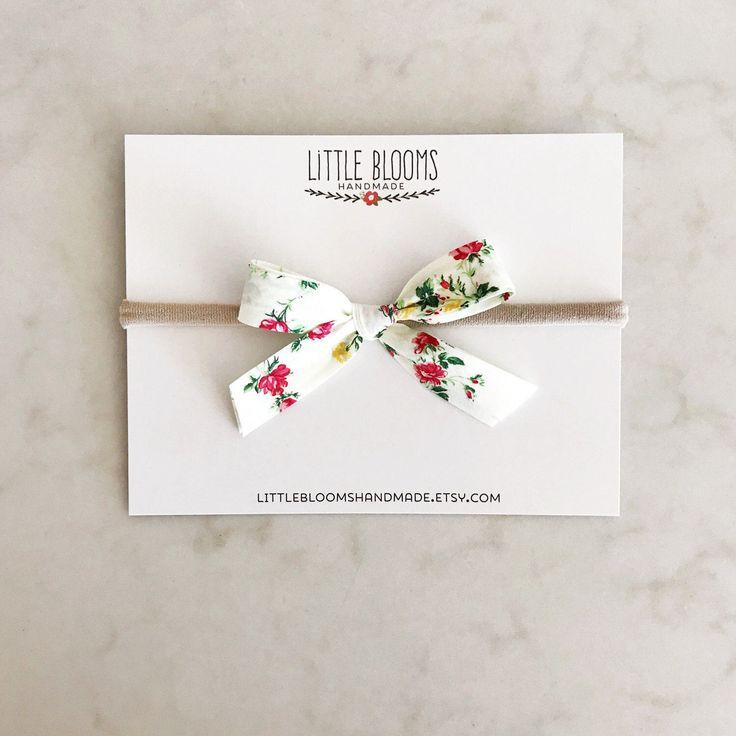Fabric Bow - Liberty of London - nylon headband or hair clip by LittleBloomsHandmade on Etsy https://www.etsy.com/listing/502312034/fabric-bow-liberty-of-london-nylon
