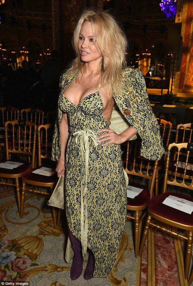 Eye-popping: Pamela Anderson still isn't shy flaunting her enviable figure as she put on an eye-popping display at Vivienne Westwood's AW17 show at Paris Fashion Week on Saturday