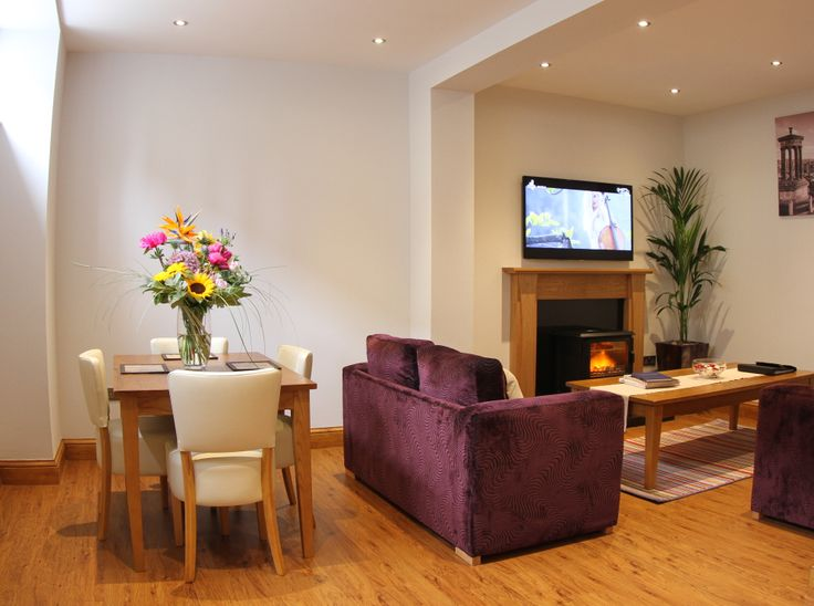 The Howard Garden Mews - Open plan lounge and dining area with flat screen wall mounted TV, two sofas and family dining table. Book this #Edinburgh #apartment today at www.thehoward.com