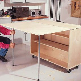 make a workbench in a day, flips up on both sides and rolls! Great space saver for sewing room