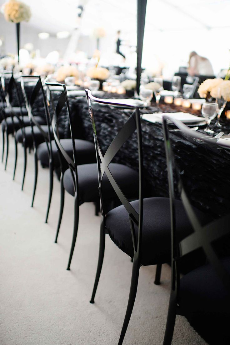 Modern Black Chairs | Photography: Kortnee Kate. Read More: http://www.insideweddings.com/weddings/black-and-white-modern-wedding-with-unique-details-in-cincinnati/698/