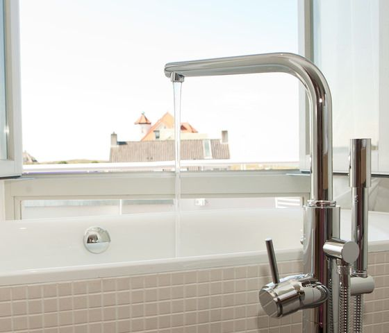Grand Vesper Suite - Vesper - The boutique hotel of Noordwijk. The Grand Vesper Suite is our grandest. It offers a truly singular experience. A breathtaking bedroom is complemented with a personal spa bathroom that includes a steam shower, a private sauna and a bath thub with sea view.  The suite includes a second bedroom or spacious private living room and a second bathroom. The 47m2 terrace balcony offers a majestic view of the shoreline and awe-inspiring sunsets.