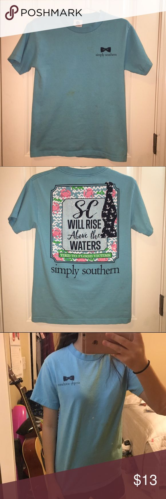 Simply Southern Sea Blue Short Sleeve T-Shirt This is a t-shirt from Simply Southern, its in overall good condition but it has a few stains on the front (picture #1&4), but can you can see from the mirror picture its not very noticeable unless you look for it! *If you have any questions please do not hesitate to ask!* I am willing to take offers, but please try to be reasonable!  (I ship really fast!!! (2-3 days) ✈️🇺🇸) *Not vineyard vines! Simple southern wasnt on here so i just put it as…