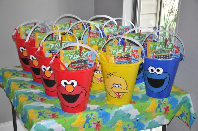 Favor idea for a fun Sesame Street Party - filled with coloring books, books, crayons, Elmo matching game, fruit snacks, and stickers (all in the Sesame Street theme).