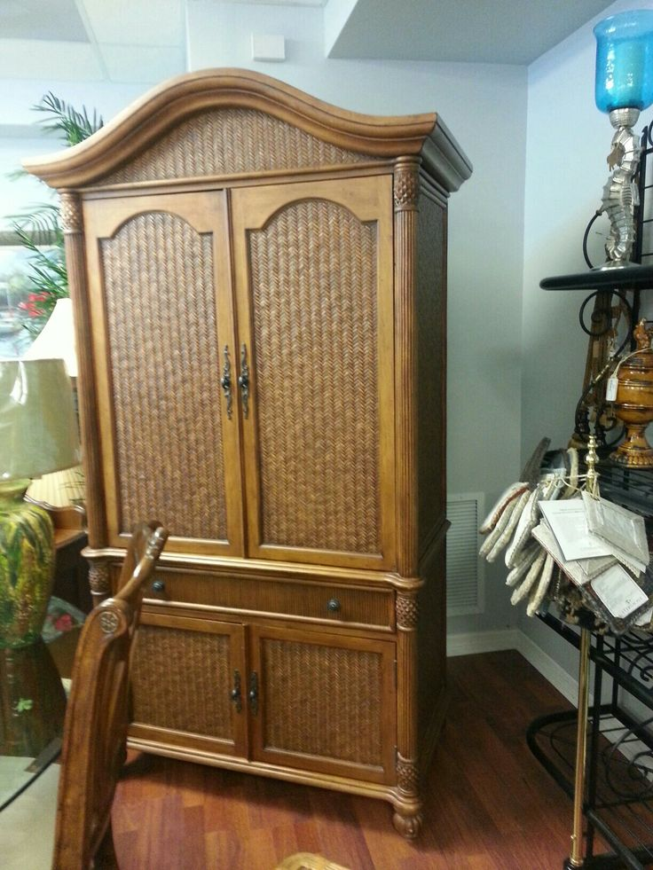 Gorgeous Rattan Armoire - Pelican Reef makes quality furniture and we have the armoire & King Headboard for sale.