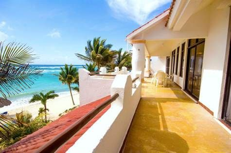 For Sale: 2-bedroom Akumal penthouse with a huge terrace and panoramic oceanfront views $449,000 USD