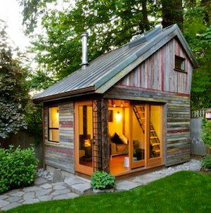 This ia a micro home built out of old barn wood. I am pondering adding a guest house repurposed  from an old smoke house.