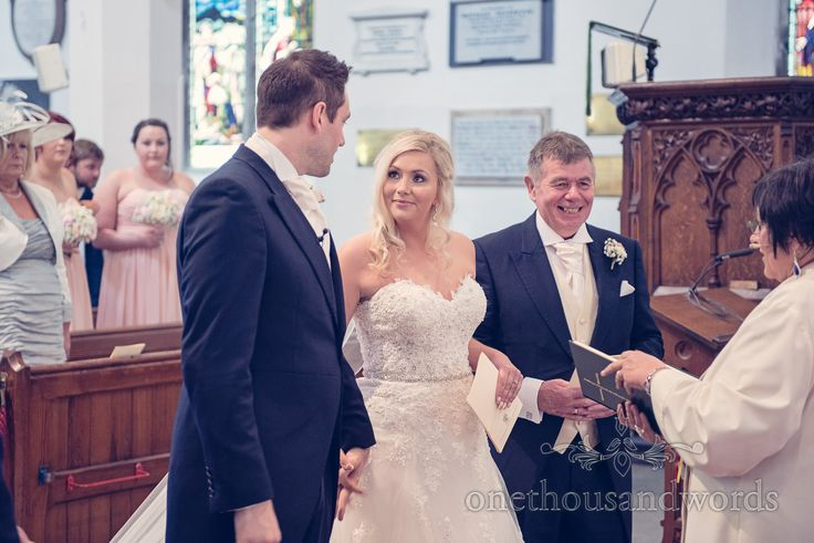 Father of bride, bride and groom at church wedding ceremony in Dorset. Photography by one thousand words wedding photographers