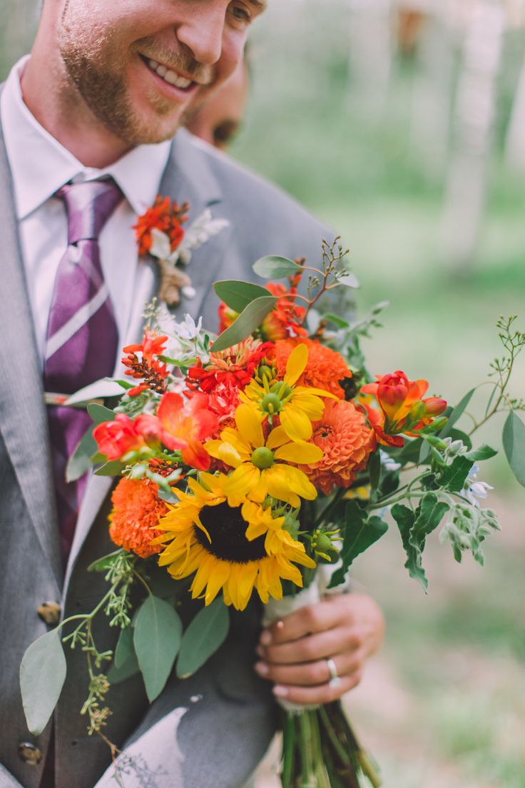 Bright and beautiful bouquet: http://www.stylemepretty.com/2015/04/09/rustic-park-city-wedding/ | Photography: Carla Boecklin - www.carlaboecklin.com