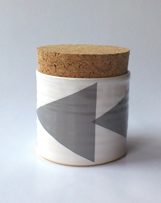 Arrow Tea or Coffee Jar with Cork Lid by Camilla Engdahl. These small pots are useful in the kitchen for tea and sugar instance. Made from earthenware clay with a glossy finish.