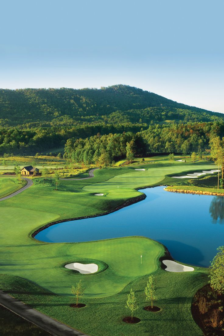 The golf course at The Cliffs at Walnut Cove is a par-71 Jack Nicklaus Signature Design course that plays through rolling fields and woodland vegetation, recognized by the PGA Tour as the only championship golf course to debut in tournament-ready condition.