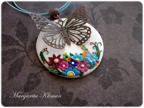 """polymerclayfimo: Флешмоб """"О себе"""" - margari_to4ka - Polymer clay pendant with a garden below a bronze metal butterfly."""